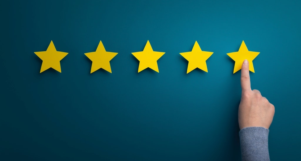 Satisfaction concept. Woman hand point at five star rating on green background, copy space, panorama